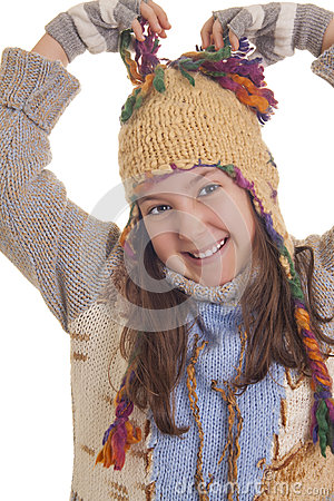 Beautiful young girl in warm winter clothes