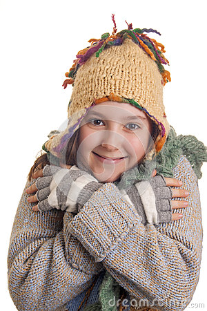 Beautiful young girl in warm winter clothes smiles