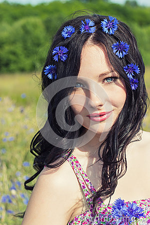 Free Beautiful Young Girl With Long Black Hair With A Wreath Of Cornflowers With Makeup Walking In The Sunny Summer Day In The Field Wi Royalty Free Stock Photography - 42873737