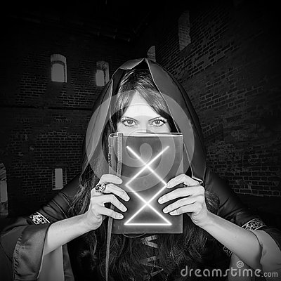 Free Beautiful Young Halloween Witch Old Magical Book Stock Photography - 60099232