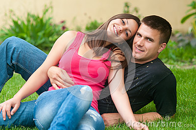 Beautiful young happy couple  in the garden