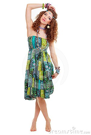 Beautiful young hippie woman in green dress