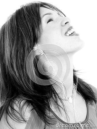 Beautiful Young Hispanic Woman Enjoying Music