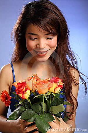 Beautiful young Japanese girl receives flowers