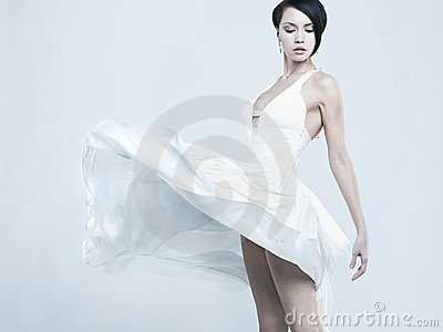 Beautiful young lady in a billowing white dress