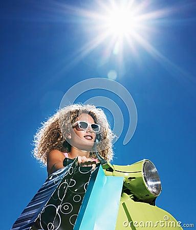 Beautiful young lady carrying shopping bag