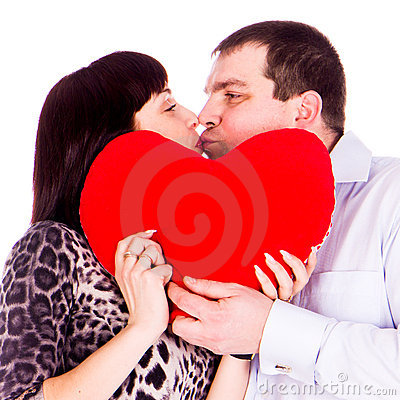 Beautiful young love couple with red heart