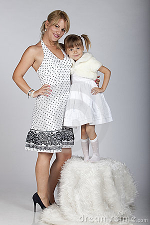 Beautiful young mother and daughter smiling