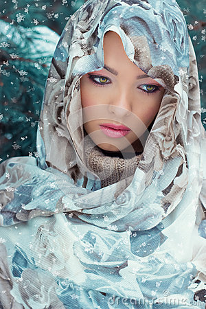 Free Beautiful Young Mysterious Woman With A Scarf On Her Head Standing In The Forest Near The Oil In Bright Winter Day Stock Image - 48269651