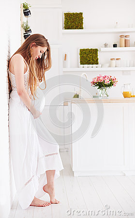 Free Beautiful Young Pregnant Woman In Frilly Summer Dress At Home Stock Image - 96354951