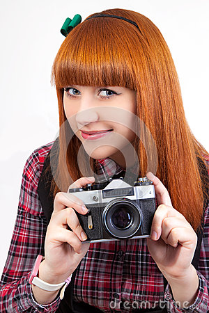 Beautiful young red - hair female with old camera