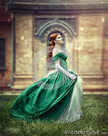 Free Beautiful, Young, Red-haired Girl In A Green Medieval Dress, Climbs The Stairs To The Castle. Stock Photo - 95267630