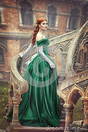 Free Beautiful, Young, Red-haired Girl In A Green Medieval Dress, Climbs The Stairs To The Castle. Fantastic Photosession. Stock Image - 95266971