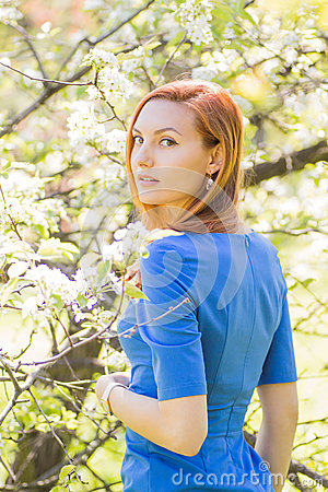 Free Beautiful Young Red-haired Girl In Blue Dress Among Spring Flowe Stock Image - 57876331