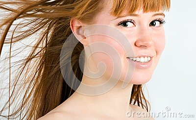Beautiful young red-haired woman