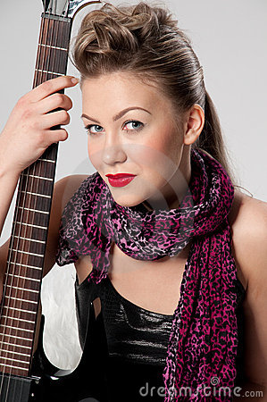 Beautiful young rock girl with black guitar