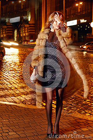 Free Beautiful Young Sexy Blonde Wearing Evening Makeup In Elegant Fitting Dress Fashionable Stylish Expensive Fur Coat Walk Night Stre Stock Photography - 63976392