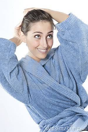 Beautiful young smiling woman in bathrobe