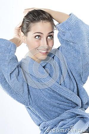 Beautiful young smiling woman in bathrobe