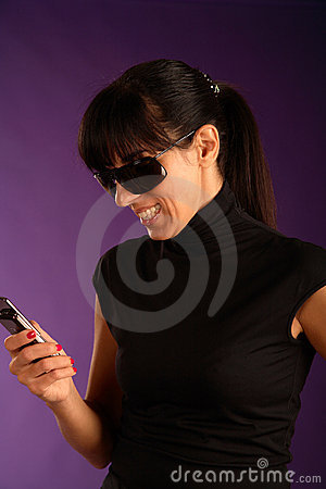 Beautiful young smiling woman with mobilephone