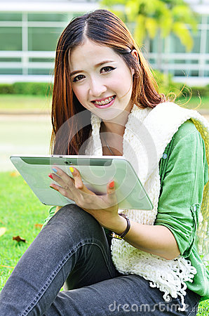 Beautiful young student learning with computer tablet