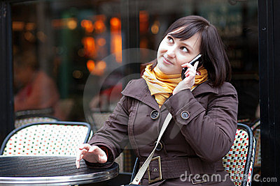 Beautiful young tourist in Paris talking by phone