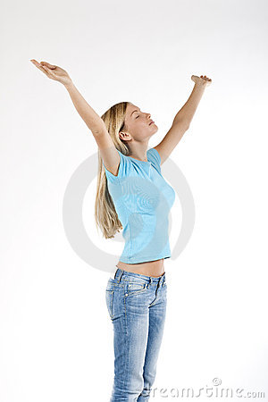 Beautiful young woman with arms raised