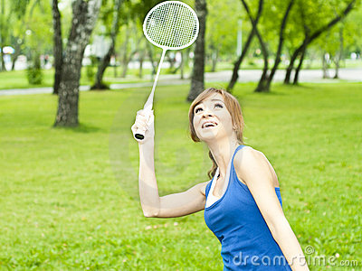 Beautiful Young Woman with Badminton racket
