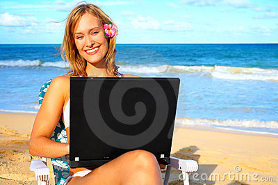 Beautiful Young Woman on the Beach with Laptop