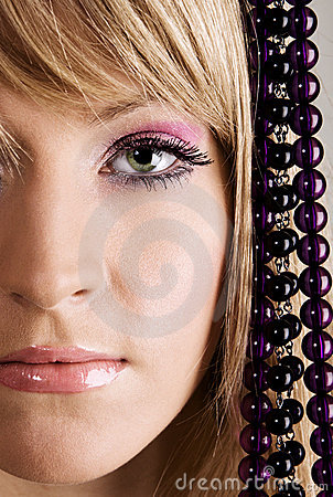 Beautiful young woman with beads