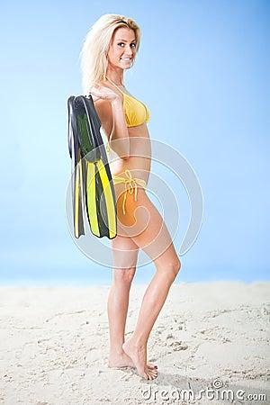 Beautiful young woman in bikini with snorkel