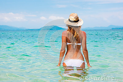 Beautiful young woman in bikini on the sunny tropi