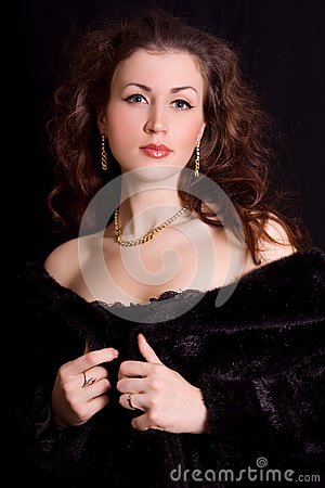 Beautiful young woman in a black fur