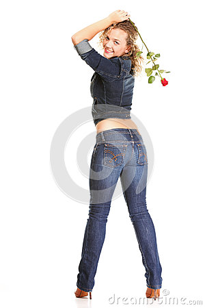Beautiful young woman blonde in jeans romantic red rose isolated