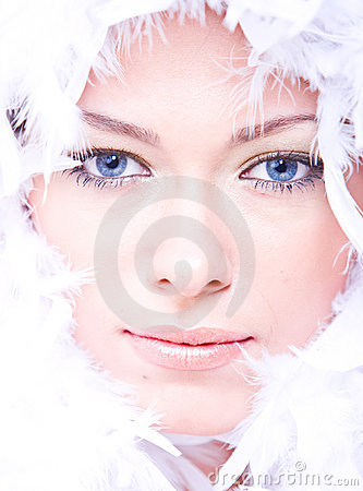 Beautiful young woman with blue eyes and boa
