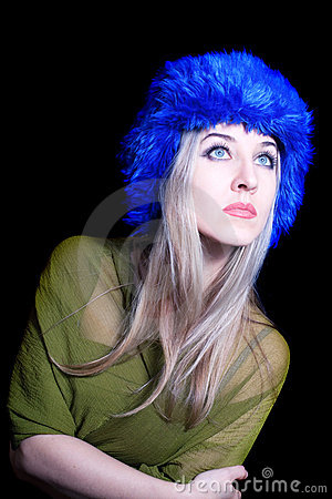 Beautiful young woman in blue winter hat