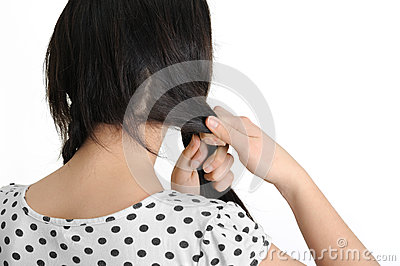 Beautiful young woman braid one s hair