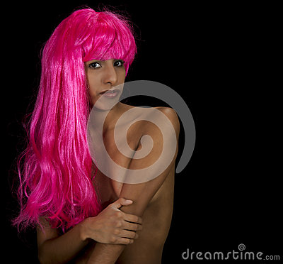 A beautiful young woman in a bright pink wig