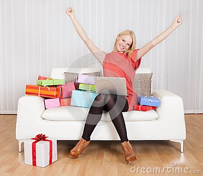 Beautiful young woman buying presents