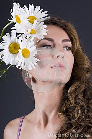 Beautiful young woman with camomile
