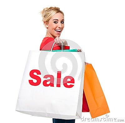 Beautiful Young Woman Carrying Sale Shopping Bag