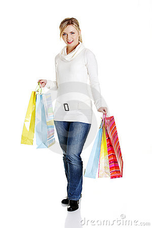 Beautiful, young, woman with colorful shopping bag