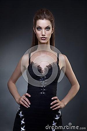 Beautiful young woman in in a dark dress