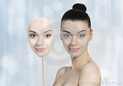 Beautiful young woman with  dark skin and light skin face mask