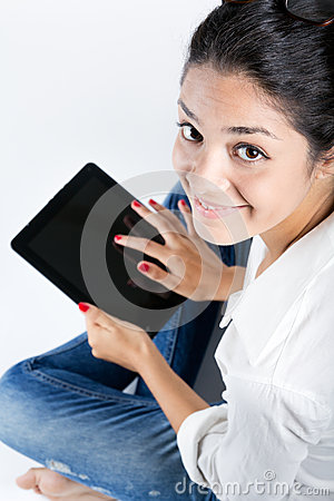 Beautiful young woman with digital tablet