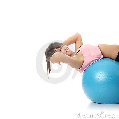 Beautiful young woman doing exercise