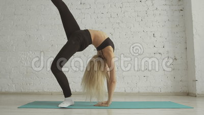 beautiful young woman doing yoga exercise stretching
