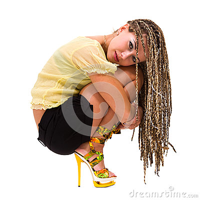 Beautiful young woman with dreadlocks siiting