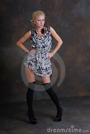 Beautiful young woman in dress and stockings