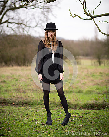 Free Beautiful Young Woman Dressed In Black Wearing Bowler Hat Stock Photos - 42879293